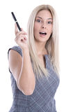 Young business woman in dress looking surprised holding pen isol Royalty Free Stock Photography