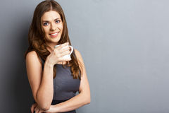 Young business woman drink coffee or tea. Royalty Free Stock Image