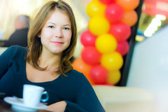 Young business woman drinking coffee Royalty Free Stock Images
