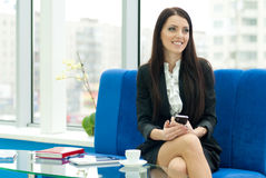 Young business woman drinking coffee Stock Photos