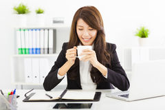 Young business woman drinking coffee in office Royalty Free Stock Photo