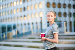 Young business woman drinking coffee outdoors Stock Photo