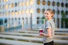 Young business woman drinking coffee outdoors Royalty Free Stock Photos