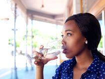 Young business woman drinking water Royalty Free Stock Photo