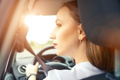 Young woman driving car in travel vacation royalty free stock photo