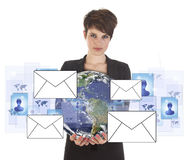 Young business woman with earth and email symbols Royalty Free Stock Photo