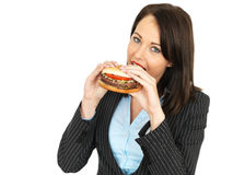Young Business Woman Eating a Beef Burger Stock Photos