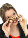 Young Business Woman Eating a Breakfast Cereal Bar Stock Photography