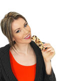 Young Business Woman Eating a Breakfast Cereal Bar Stock Images