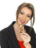 Young Business Woman Eating a Breakfast Cereal Bar Royalty Free Stock Photo