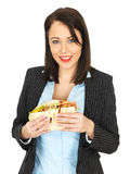 Young Business Woman Eating a Chicken Kebab Royalty Free Stock Photo