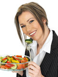 Young Business Woman Eating a Fresh Mixed Salad Royalty Free Stock Photos