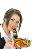 Young Business Woman Eating a Fresh Mixed Salad Stock Images