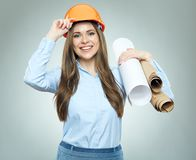 Young business woman engeneer, architect holding rolled up techn Royalty Free Stock Images