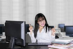 Young business woman expressing happy in office stock images