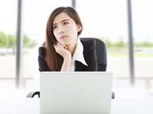 Young business woman feel unhappy in the office Stock Photos