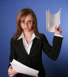 Young business woman with a file in her hands. Portret of a young smiling business woman holding a boring file in her hands Royalty Free Stock Photo