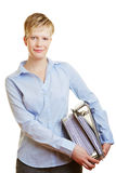 Young business woman with files Stock Images