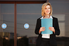 Young business woman with a folder Royalty Free Stock Photography
