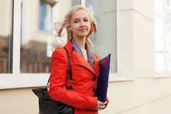 Young business woman with a folder Royalty Free Stock Photos