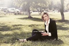 Young business woman with a folder in a city park Royalty Free Stock Photography