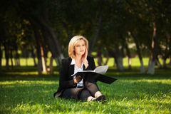 Young business woman with a folder on nature Stock Images