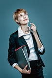 Young business woman with folder thinking Stock Photography