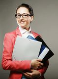 Young business woman with folders Royalty Free Stock Image