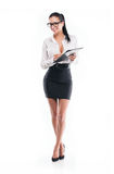 Young business woman with form and pencil Royalty Free Stock Photos