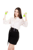 Young business woman in formalwear lifts dumbbells Stock Photography