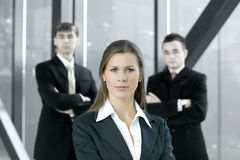 A young business woman in front of her colleagues Stock Photos
