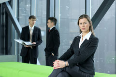 A young business woman in front of her colleagues Royalty Free Stock Image