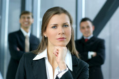 A young business woman in front of her colleagues Stock Photography