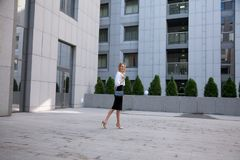 Young business woman in front of office building stock photos