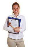 Young business woman with gavel royalty free stock photo