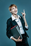 Young business woman gesturing with finger and holding a folder Stock Image