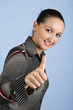 Young business woman give thumbs up. And smiling isolated on blue background,check also Business people ,laptop and money Royalty Free Stock Photos