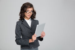 Young business woman in glases using tablet Stock Photo