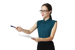 Young business woman in glasses gives a pen to sign the document Stock Image