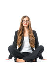 Young business woman with glasses sitting on floor Royalty Free Stock Photos