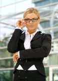Young business woman with glasses standing outdoors Royalty Free Stock Photo