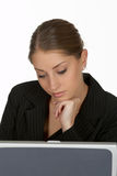 Young Business Woman with Hand on Chin at Laptop Royalty Free Stock Photos