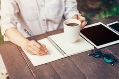 Young business woman hand with pencil writing on notebook. Woman Royalty Free Stock Image