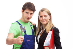 Young business woman and handyman Royalty Free Stock Images