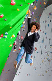 Young business woman hanging at wall, beautiful girl Stock Image