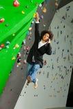 Young business woman hanging at wall, beautiful girl Stock Photos