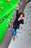 Young business woman hanging at wall, beautiful girl Royalty Free Stock Photos