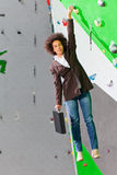Young business woman hanging at wall, beautiful girl Stock Photo