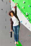 Young business woman hanging at wall, beautiful girl Royalty Free Stock Photography