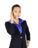 Young business woman has a conversation on a mobile pho Royalty Free Stock Image